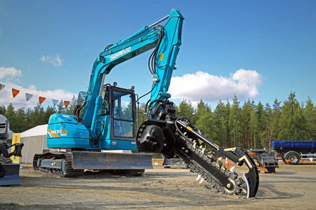 trencher: HYVINKAA, FINLAND - SEPTEMBER 11, 2015: Sunward SWE90UB excavator mounted trencher at MAXPO 2015.