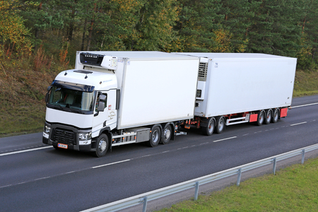 RIIHIMAKI, FINLAND - SEPTEMBER 26, 2015: Renault T reefer truck drives along motorway. Refrigerated trucks can haul a variety of goods that require climate-controlled handling.