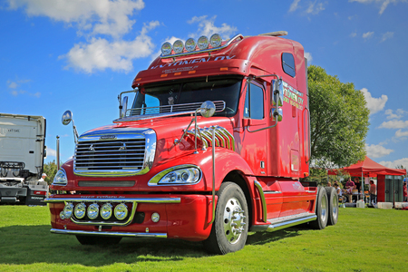 freightliner: ALAHARMA, FINLAND - AUGUST 7, 2015:  Red Freightliner truck tractor on display in Power Truck Show 2015. Editorial