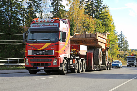 oversize: PARAINEN, FINLAND - OCTOBER 9, 2015: Volvo FH hauls a Volvo BM 540 Rigid dump truck as wide load. The BM 540 was designed a cost-effective load carrier for construction and mining. Editorial