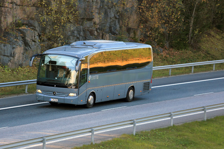 RIIHIMAKI, FINLAND - OCTOBER 10, 2015: Grey Mercedes-Benz bus on motorway. Safety systems play a pre-eminent role in the buses and coaches from Daimler.