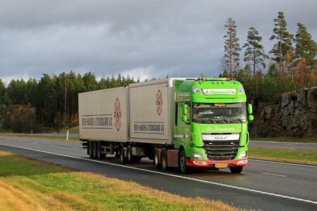 introduces: SALO, FINLAND - OCTOBER 23, 2015: Lime green DAF XF full trailer truck on motorway. DAF introduces new products at Amsterdam RAI show in October 2015.