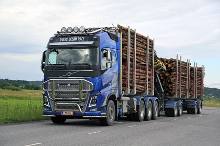 logging truck: SALO, FINLAND - JULY 10, 2015: Volvo FH16 logging truck with a full timber load. CEPI informs that the European consumption of paper and paperboard is changing shape, but growing.