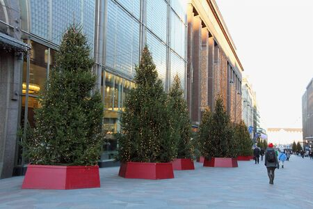 flagship: HELSINKI, FINLAND - DECEMBER 2, 2015: Christmas trees on Keskuskatu by the flagship Stockmann store in Finland. Stockmann is the largest department store in Nordic countries. Editorial