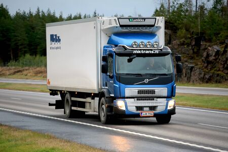 urban transport: PAIMIO, FINLAND - NOVEMBER 6, 2015: Blue Volvo FE refrigerated transport truck on motorway. Volvo FE is a multi-purpose vehicle for city and regional transport. Editorial