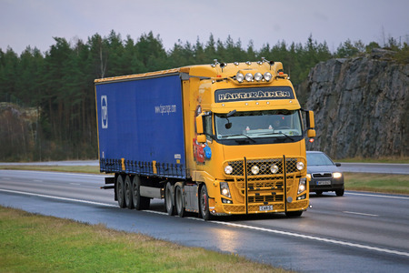 is well known: PAIMIO, FINLAND - NOVEMBER 6, 2015: Volvo FH13 Semi truck with Cars Movie Theme on motorway. The FH13 of Trans-Hartikainen is a well known Finnish show truck. Editorial