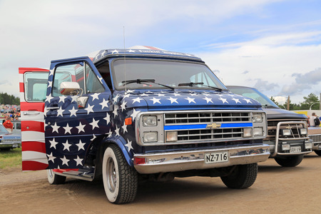 picknick: FORSSA, FINLAND - AUGUST 2, 2015: Third generation of Chevrolet van with stars and stripes on display on Pick-Nick Car Show in Forssa, Finland.