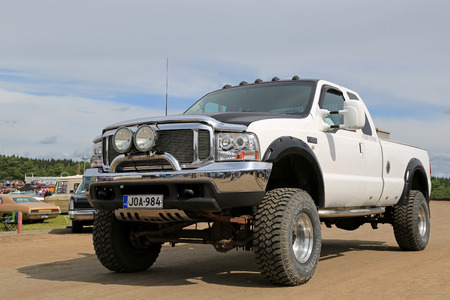 picknick: FORSSA, FINLAND - AUGUST 2, 2015: White Ford Super Duty F250 pickup truck on Pick-Nick Car Show in Forssa, Finland.