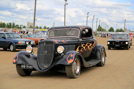 picknick: FORSSA, FINLAND - AUGUST 2, 2015: Tuned up classic Ford Hot Rod car on Pick-Nick Car Show in Forssa, Finland.