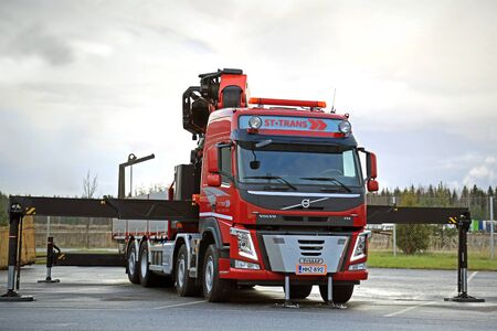fm: LIETO, FINLAND - NOVEMBER 14, 2015:  Volvo FM 500 equipped with heavy crane of ST-Trans is displayed at the Volvo Truck Center Turku Demo Drive and Tire Service Event.