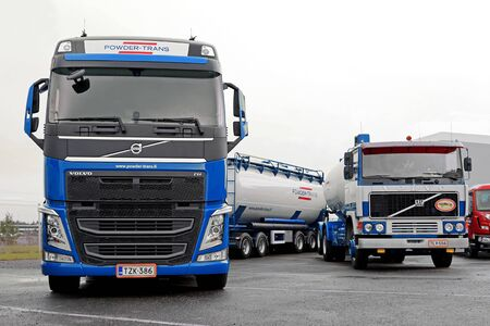 nostalgy: LIETO, FINLAND - NOVEMBER 14, 2015: New Volvo FH and classic Volvo F1125 combination vehicles of Powder-Trans Oy for bulk transport at the Volvo Truck Center Turku Demo Drive and Tire Service Event.
