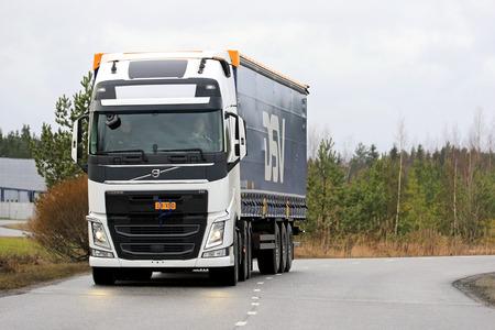 drivers: LIETO, FINLAND - NOVEMBER 14, 2015:  Unidentified drivers take Volvo FH 500 semi on a test drive at the Volvo Truck Center Turku Demo Drive and Tire Service Event. Editorial
