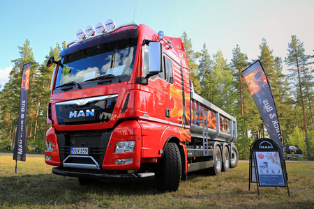 se: HYVINKAA, FINLAND - SEPTEMBER 11, 2015: New MAN TGX D38 35.560 tipper truck for construction on display at the exhibition for land construction and environmental maintenance machines MAXPO 2015.