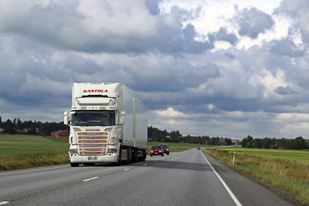 refrigerated: LUOPAJARVI, FINLAND - AUGUST 6, 2015: Scania R500 temperature controlled truck on the road in Ostrobothnia. Refrigerated trucks can haul a variety of goods that require a climate-controlled handling.