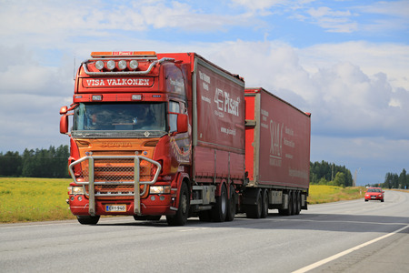 hauling tractor: LUOPAJARVI, FINLAND - AUGUST 6, 2015: Scania trailer truck of Trans Harma Visa Valkonen, Finland on the road in Luopajarvi. Valkonen is a Finnish haulier known of customized heavy trucks.