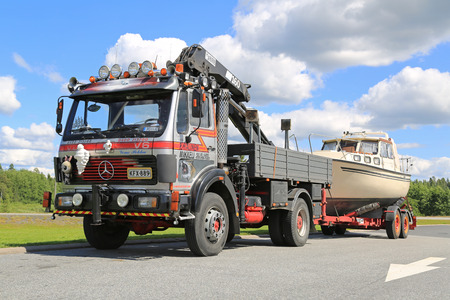 rigid: FORSSA, FINLAND - JULY 25, 2015: Customized Mercedes-Benz 1622 rigid truck for boat transport with mobile crane in Forssa. The 1622 belongs to the MB new generation launched in the 1970s. Editorial