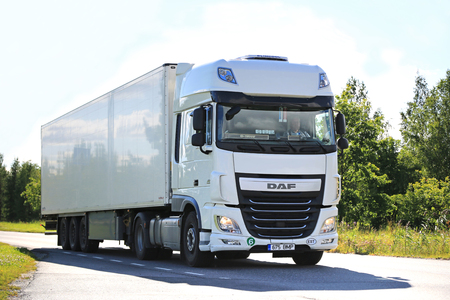 salo: SALO, FINLAND - JULY 24, 2015: New white DAF XF semi truck on summer road in Salo. PACCAR reports strong revenues and net income for the Q3 of 2015. Editorial