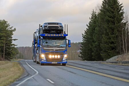 fm: SALO, FINLAND - DECEMBER 11, 2015: Volvo FM car carrier of Kurbads hauls new cars. The Finnish automotive industry estimates that a total of 109,000 new passenger cars will be sold in Finland in 2015.