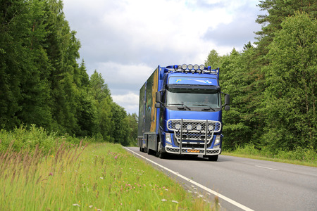 floriculture: SALO, FINLAND - JULY 19, 2015:  Dutch Volvo FH flower transport truck on rural road in Southwest of Finland in July. The Netherlands is the largest player in floriculture worldwide.