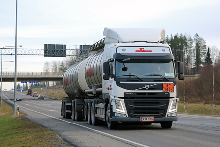 fm: FORSSA, FINLAND - DECEMBER 12, 2015: Volvo FM tank truck in ADR haul. The ADR code 18-1824 signifies sodium hydroxide solution.