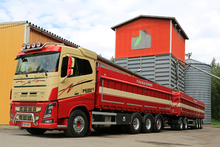 tonnes: SOMERO, FINLAND - JULY 4, 2015: Volvo FH16 750 combination vehicle for grain transport in front of a grain dryer. Finland produces 4 Million tonnes of grain and oilseed annually.