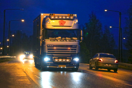 floriculture: SALO, FINLAND - APRIL 12, 2015: Dutch DAF XF105 Flower truck on the road late at night in Finland. The Netherlands is the largest player in floriculture worldwide.