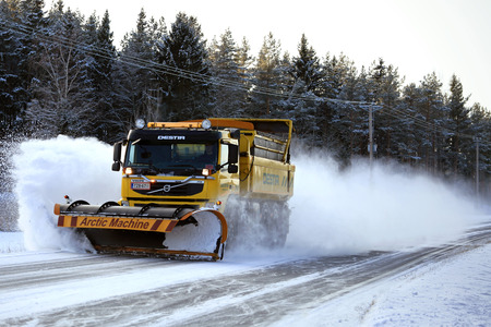 fm: SAUVO, FINLAND - JANUARY 17, 2016: Volvo FM road maintenance truck equipped with Arctic Machine snowplow clears a highway in South of Finland. Destia takes care of the winter maintenance of the Finnish roads.