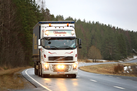light duty: SALO, FINLAND - JANUARY 30, 2016: White Volvo FH16 Semi transports goods in South of Finland. The truck driver flashes the headlights for a greeting.