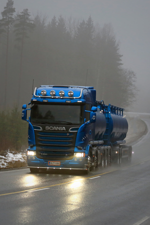 light duty: SALO, FINLAND - FEBRUARY 7, 2016: New, blue Scania R580 V8 tank truck on the road on a foggy winter afternoon in South of Finland. Scania celebrates 125 years in 2016. Editorial