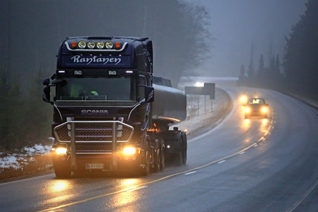 road conditions: SALO, FINLAND - FEBRUARY 7, 2016: Scania semi tank truck R500 on the road in fog. Finnish weather conditions can change rapidly in winter. Editorial
