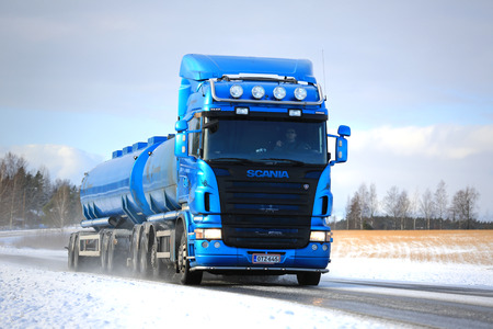 SALO, FINLAND - FEBRUARY 6, 2016: Blue Scania R500 tank truck on the road in winter weather. In 2015, Scania is Finnish the market leader in heavy trucks.