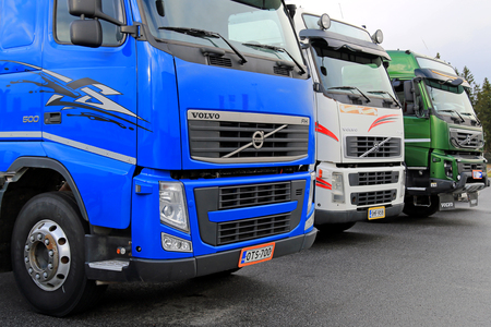 lineup: LIETO, FINLAND - NOVEMBER 14, 2015: Lineup of three used Volvo trucks as seen on the Volvo Truck Center Turku Demo Drive and Tire Service Event.
