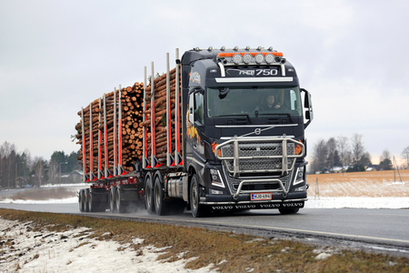 logging truck: SALO, FINLAND -  FEBRUARY 19, 2016: Volvo FH16 750 logging truck hauls pulp wood along highway in South of Finland. The new bioproduct mill of Metsa Group, currently under construction, will increase the demand of pulp wood in future.