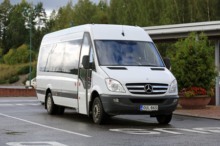 SALO, FINLAND - SEPTEMBER 5, 2015: White Mercedes-Benz Sprinter minibus stops at bus parking in South of Finland. The MB Sprinter has a seating capacity from 13 to 19 passengers. 報道画像