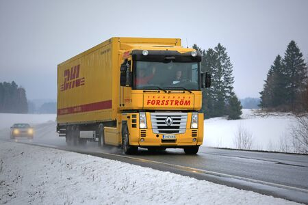magnum: SALO, FINLAND - FEBRUARY 21, 2016: Yellow Renaut Magnum semi truck on the road in Finnish winter weather. Renault Magnum was manufactured in 1990-2013 and it received the International Truck of the Year award in 1991. Editorial