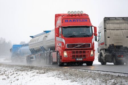 highway 3: SALO, FINLAND - FEBRUARY 26, 2016: Tank trucks and a tractor unit are moving in opposite direction along highway in winter snowfall in Salo, Finland.