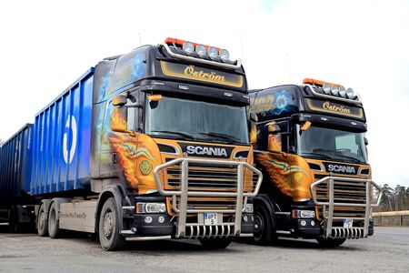 combinations: RAISIO, FINLAND - APRIL 5, 2015: Two new Scania R560 Euro 6 V8 truck trailer combinations parked at a truck stop in Raisio. The two customized tractors possess great similarity.