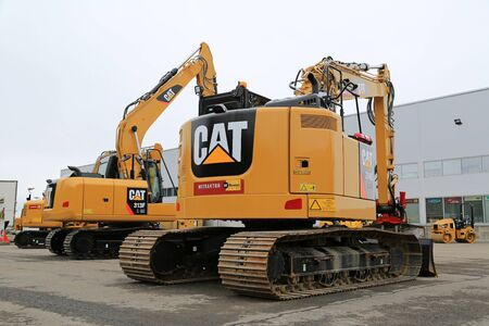 mini loader: LIETO, FINLAND - MARCH 12, 2016: Cat 314E LCR and 313 F hydraulic excavators along with other Cat construction equipment seen at the public event of Konekaupan Villi Lansi Machinery Sales.
