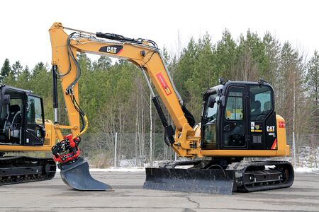 LIETO, FINLAND - MARCH 12, 2016: Cat 308E2CR Mini Hydraulic Excavator as seen at the public event of Konekaupan Villi Lansi Machinery Sales.