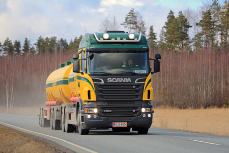 light duty: SALO, FINLAND - APRIL 1, 2016: Colorful Scania R500 tank truck for bulk transport on the road in South of Finland. Scania celebrates 125 years in 2016. Editorial