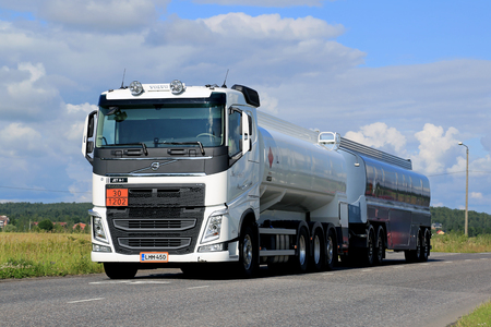 ard: SALO, FINLAND - JULY 17, 2015: White Volvo FH tank truck in ARD haul along urban road at summer. The ADr code 30-1202 stands for diesel fuel.