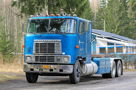 heavy duty: SALO, FINLAND - APRIL 24, 2016: Classic blue International Eagle 9670 cab over heavy duty truck parked along road in South of Finland.