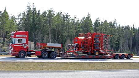 seed drill: PAIMIO, FINLAND - APRIL 15, 2016: Scania R620 Semi truck hauls Vaderstad Spirit 800C seed drill along motorway in high speed. Editorial