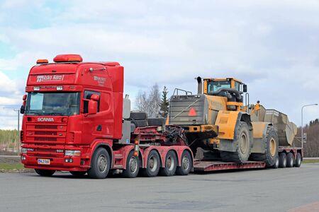 oversize load: FORSSA, FINLAND - APRIL 23, 2016: Scania 164G truck stops at Forssa truck stop during the oversized transport of heavy Volvo L350F wheel loader.