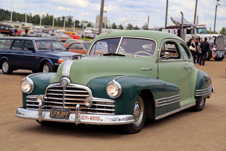picknick: FORSSA, FINLAND - AUGUST 2, 2015: Classic car Pontiac of two tone green color on the public event of Pick-Nick Car Show. Editorial