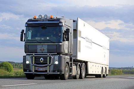 magnum: SALO, FINLAND - MAY 13, 2016: Grey Renault Magnum semi truck transports mobile MRI unit in South of Finland on a blue spring evening. Editorial