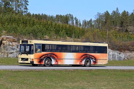 omnibus: PAIMIO, FINLAND - MAY 6, 2016: A bus with wheels as eyes artwork moves along motorway in south of Finland.