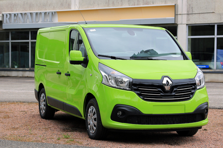trafic: RAASEPORI, FINLAND - MAY 15, 2016: Lime green Renault Trafic DCi 140 parked on a yard. Editorial