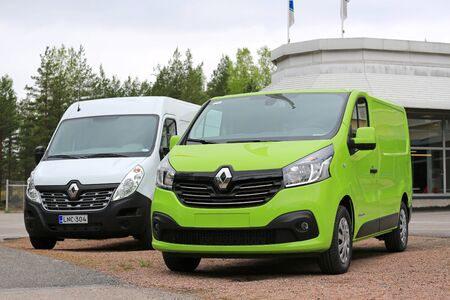 trafic: RAASEPORI, FINLAND - MAY 15, 2016: Lime green Renault Trafic DCi 140 and White Renault Master van parked on a yard. Editorial