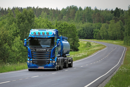 highway 6: SALO, FINLAND - JUNE 5, 2016: New blue Scania Euro 6 tank truck for bulk transport on summer highway in South of Finland.